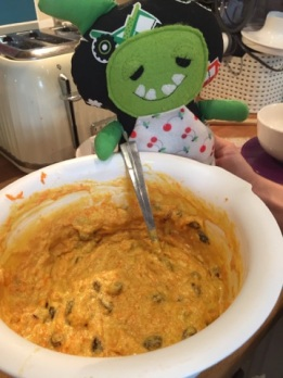 Bob is helping the children mix up the cake mixture!