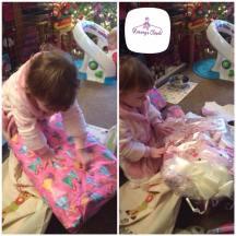 Little Girl opening Keepsake Blanket Christmas